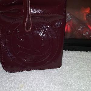 Small Etienne Aigner wristlet purse